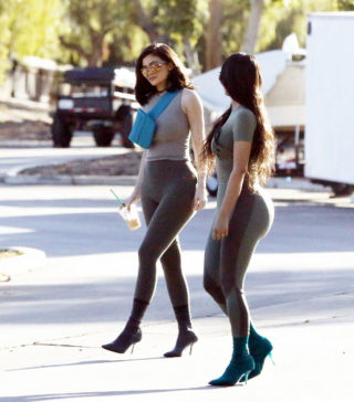 Kylie Jenner and Kim Kardashian in skintight grey and black halter tops and leggings in Calabasas