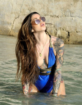 Darylle Sargeant in swimsuit at the Beach in Spain
