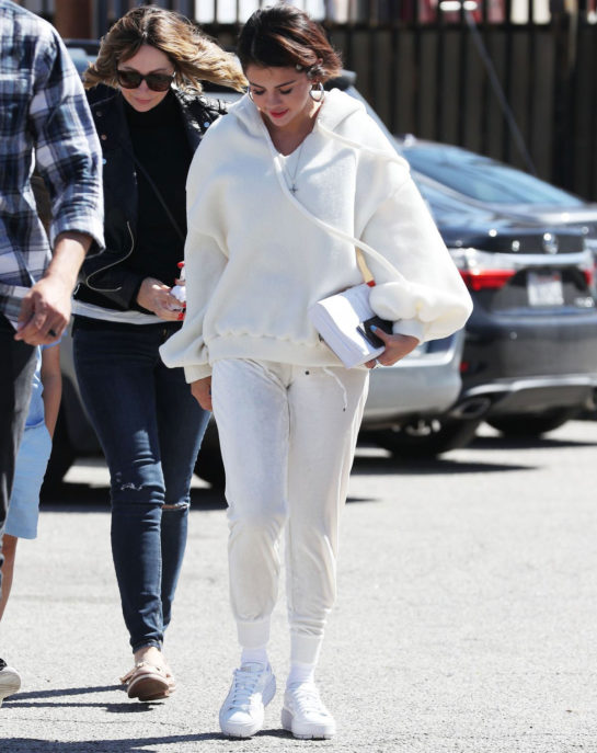 Selena Gomez arriving at an ice skating rink in Los Angeles