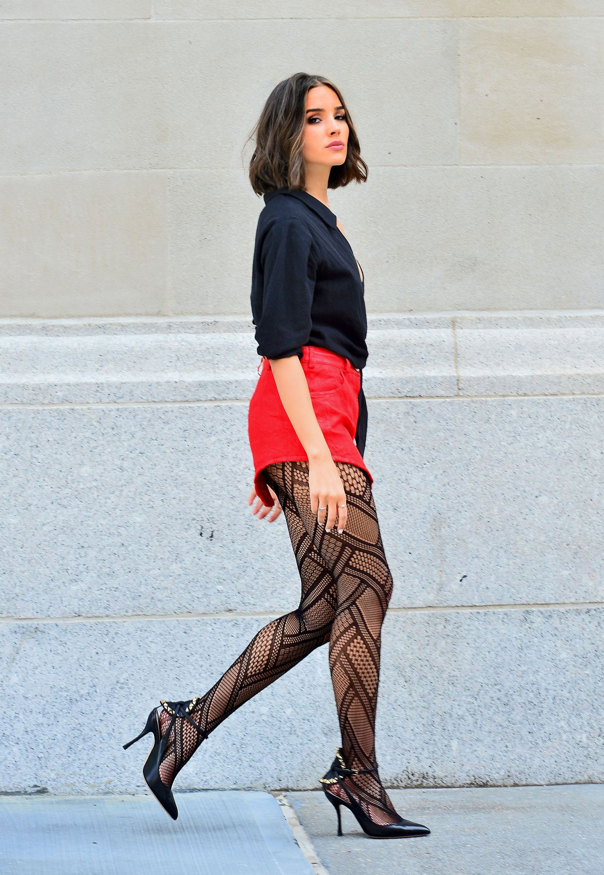 43a0504caf294 Olivia Culpo in Fishnet Tights and Red Shorts at a Photoshoot in New York