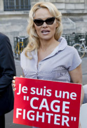 Pamela Anderson Protests Breeding of Animals in Cages in Paris