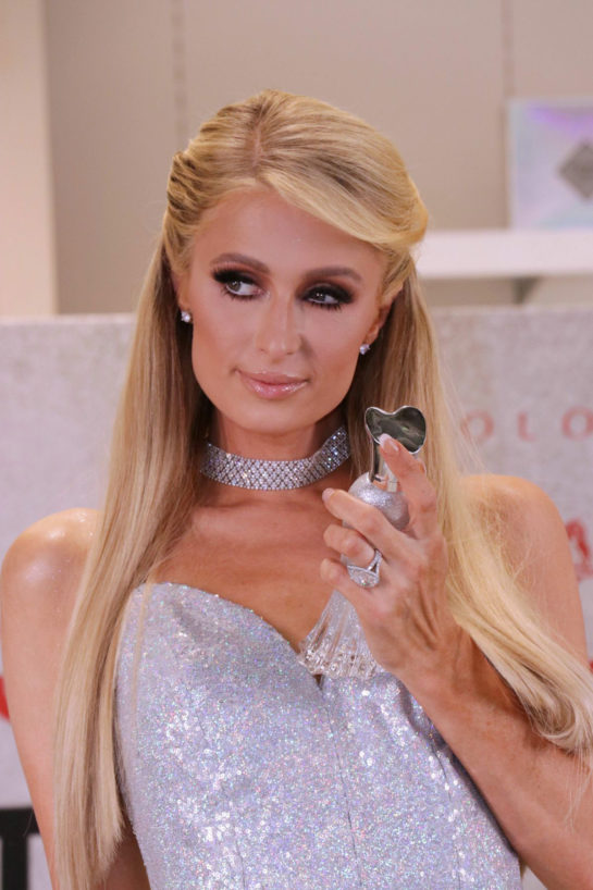 Paris Hilton promoting her new perfume Platinum Rush
