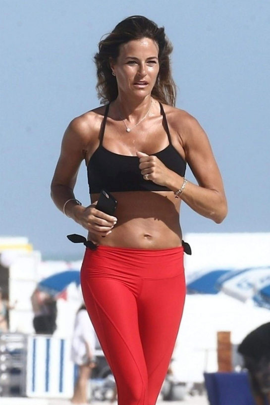 Kelly Bensimon out for a jog on the beach in Miami
