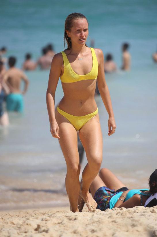 Sailor Brinkley Cook in a yellow bikini at Bondi Beach