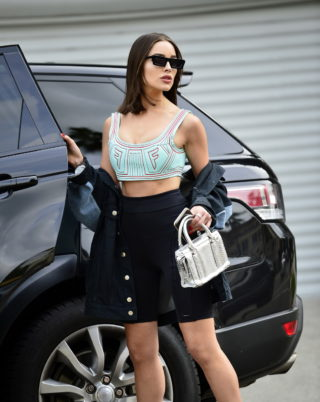 Street Style - Olivia Culpo in a Skimpy Sports Bra and Black Biker Shorts