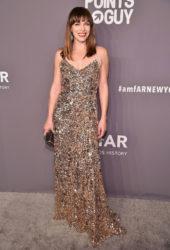 Milla Jovovich in Shiny Gold Gown at 2019 amfAR New York Gala