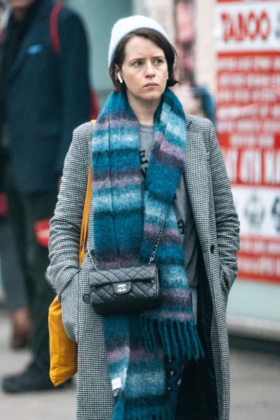 Claire Foy in a Baby Blue Beanie Hat and Layers of Clothing Leaves Bodyism in London