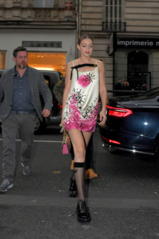 Gigi Hadid in Printed Mini-Dress and Sheer Socks Arrives at the Vogue Party in Paris
