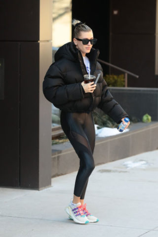Hailey Bieber rocks a black puffer jacket with matching leggings in New York