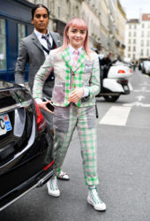 Maisie Williams in a green and white checked jacket and matching trousers, both of which were adorned with baby pink ducks at Thom Browne Fashion Show in Paris