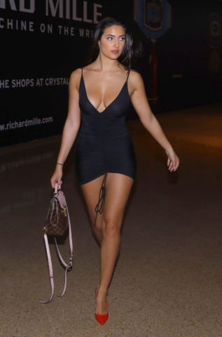 Tao Wickrath in a black mini dress out shopping at a luxury mall in Las Vegas