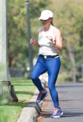 Reese Witherspoon in blue yoga pants as she enjoys jog in LA