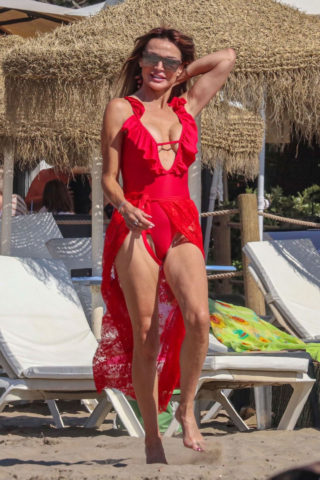 Lizzie Cundy in Red Swimsuit on the beach in Marbella