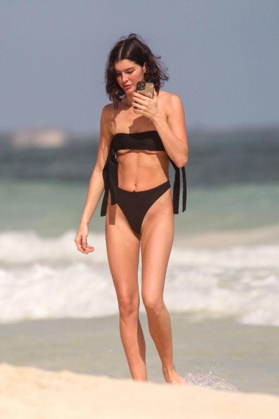 Bella Banos in Black Bikini at a beach in Tulum