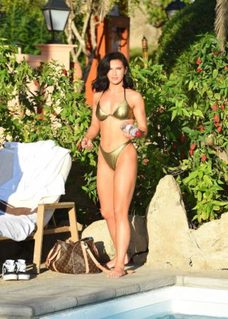 Alexandra Cane in a Gold Bikini for Her Fitness App in Tenerife