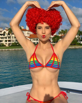 Amanda Cerny in Bikini with a Red Wig at a Boat