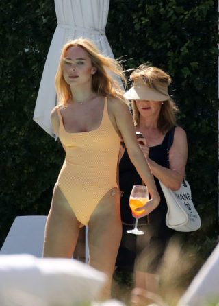 Kimberley Garner in an orange swimsuit at a pool in Miami
