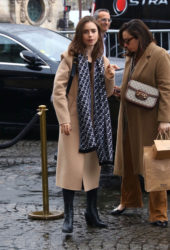 Lily Collins wearing a tan coat and scarf while out in Paris