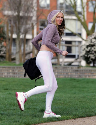 Caprice Bourret headed to a London park to practice some yoga
