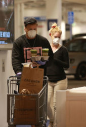 Heidi Montag and Spencer Pratt with face masks and latex gloves shopping at Erewhon Market in Pacific Palisades, CA