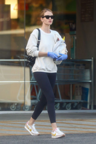 Rosie Huntington-Whiteley Puts on a mask to enter Rite Aid in LA