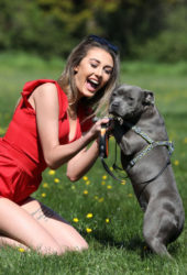Chloe Veitch with Her Dog Paris at a Park in Essex