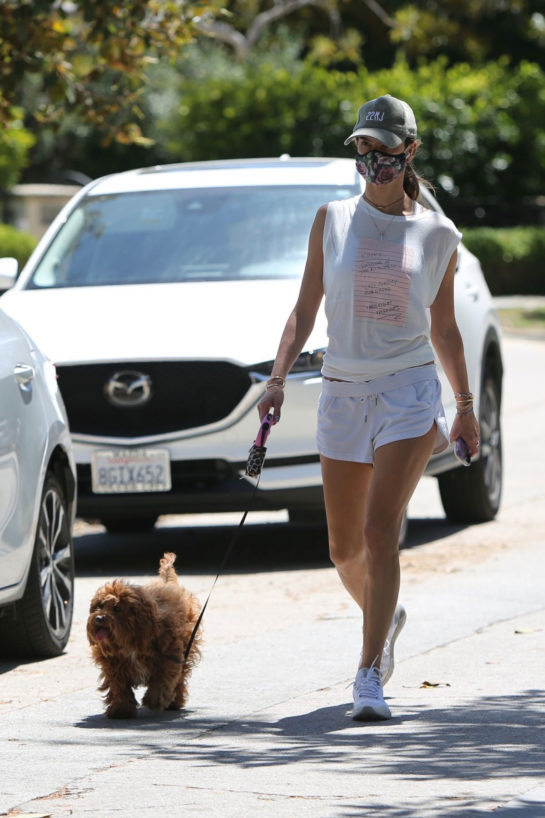 Alessandra Ambrosio wearing white shorts while walking her dog in Brentwood