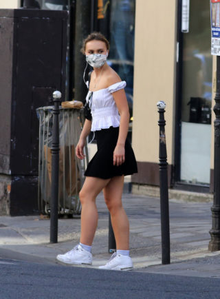 Lily-Rose Depp wears face mask and mini skirt in Paris