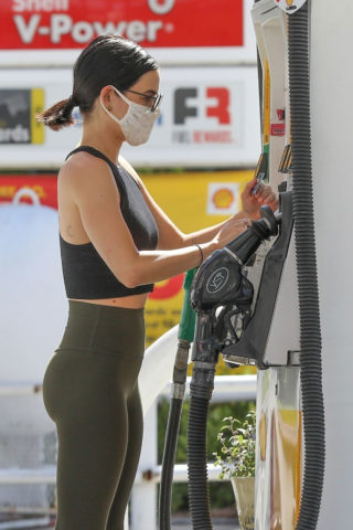 Lucy Hale in Green Tights at a gas station in Studio City