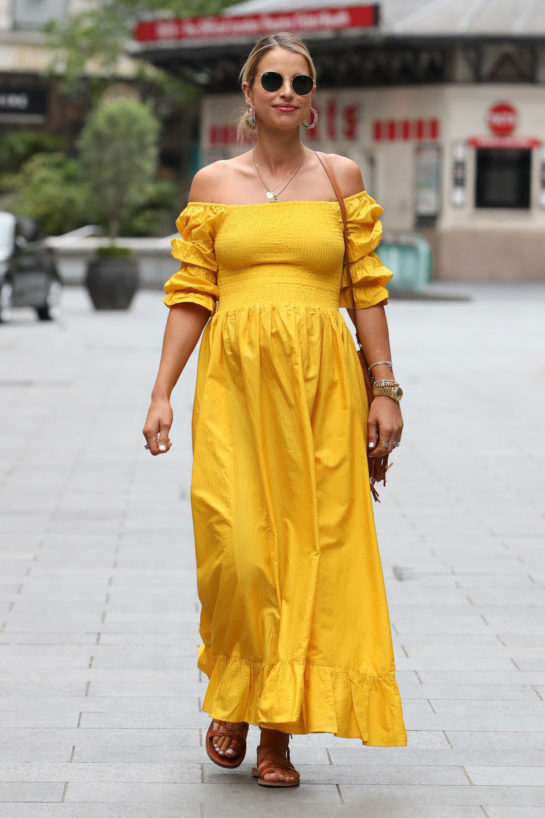 Vogue Williams Wearing a yellow dress while arriving at Global Radio in London