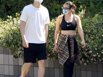 Charli XCX and Huck Kwong protect with face masks as they go for a walk in Los Angeles