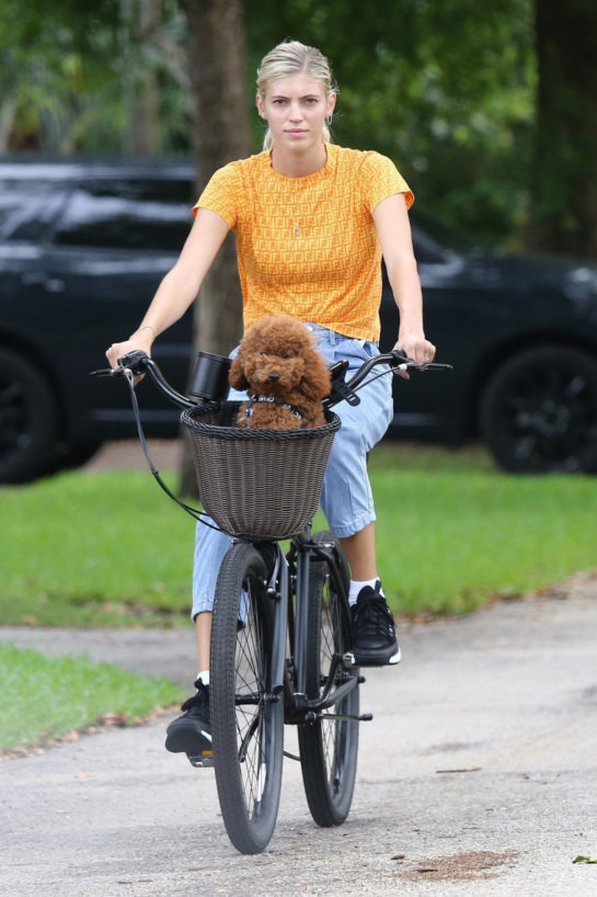 Devon Windsor Out Riding a Bike with Her Dog in Miami