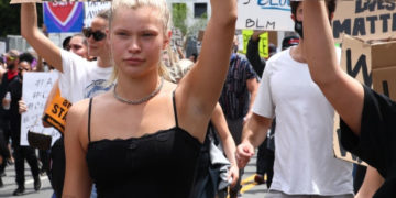 Josie Canseco walks with protesters in Los Angeles