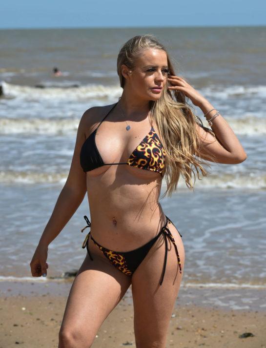 Megan Clark in Black Bikini on the beach in Frinton