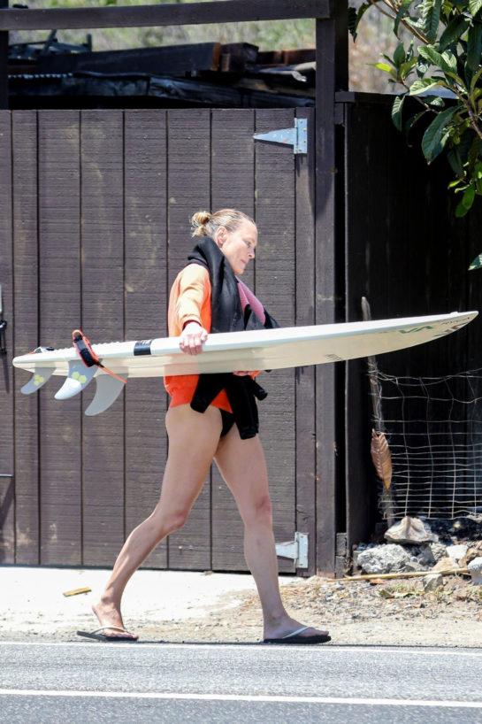 Robin Wright Surfing at a beach in Malibu