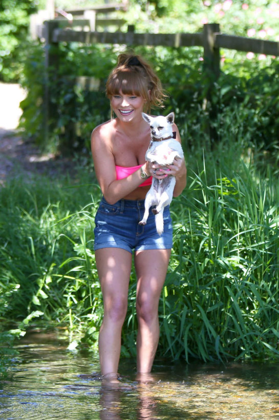 Summer Monteys-Fullam takes her dog for a walk in Green Fields in London