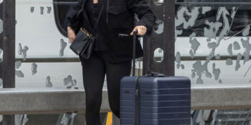 Jodie Comer catching a train from Liverpool back down to London