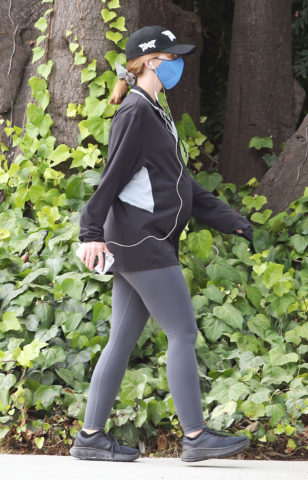 Pregnant Katherine Schwarzenegger steps out for her daily walk in Brentwood