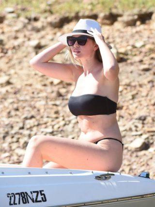 Amy Hart in a Black Bikini at a Beach in Portugal