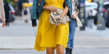 Famke Janssen in a Bright Yellow Dress and Denim Jacket
