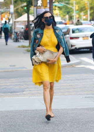 Famke Janssen in a Bright Yellow Dress and Denim Jacket