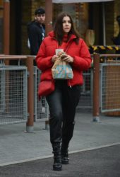 Imogen Thomas in a red jacket and leather trousers at McDonald's in Chelsea