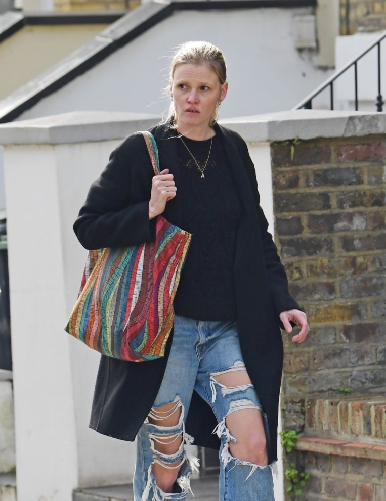 Lara Stone in Ripped Denim Out in London